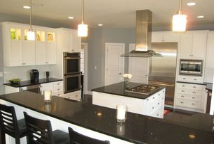 Traditional Kitchen with Soapstone counters, Crown molding, Kitchen island, Breakfast bar, Large Ceramic Tile, U-shaped
