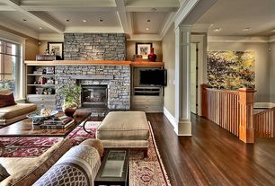 Traditional Living Room with Wood top and iron scroll leg coffee table, stone fireplace, Crown molding, Built-in bookshelf