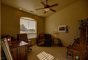 Mediterranean Home Office with Ceiling fan, Carpet, Arched window, can lights, Standard height