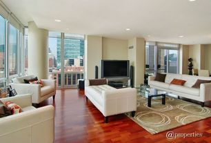 Contemporary Living Room with Laminate floors, French doors