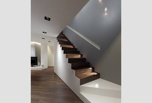 Modern Staircase with Hardwood floors, Pendant light