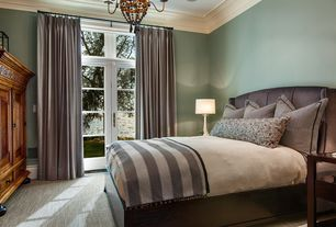 Traditional Master Bedroom with Transom window, Paint, Standard height, Carpet, Upholstered headboard, French doors