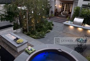 Contemporary Patio with exterior stone floors, Pathway, French doors, Outdoor kitchen, Fence, Fire pit