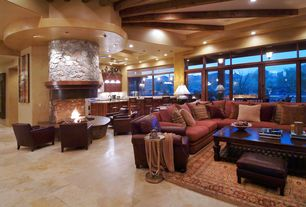Contemporary Great Room with travertine tile floors, Built-in bookshelf, Real flame mezzo round fire table, stone fireplace