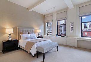 Contemporary Master Bedroom with Built-in bookshelf, flush light, Exposed beam, Carpet