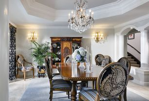 Traditional Dining Room with Columns, Wall sconce, Chandelier, Concrete tile , Crown molding
