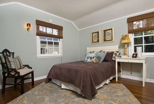 Eclectic Guest Bedroom with Wall sconce, Bamboo floors, Crown molding