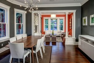 Contemporary Dining Room with Hardwood floors, Crown molding, Chandelier, Columns