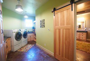 Traditional Laundry Room with Barn door, Concrete tile , Pendant light, Built-in bookshelf
