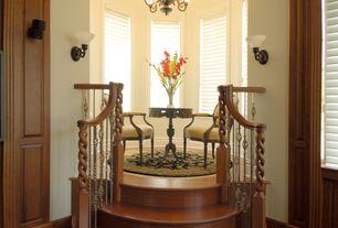 Traditional Hallway with Hardwood floors, Wall sconce