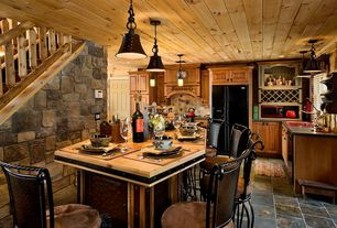 Rustic Kitchen with L-shaped, Raised panel, Standard height, dishwasher, stone tile floors, Soapstone counters, Custom hood