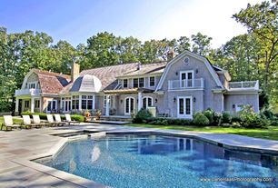 Traditional Swimming Pool with exterior stone floors, Fence, Pathway, French doors, Outdoor kitchen