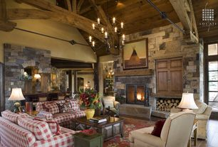 Country Living Room with French doors, Exposed beam, stone fireplace, Cathedral ceiling, Chandelier, flush light