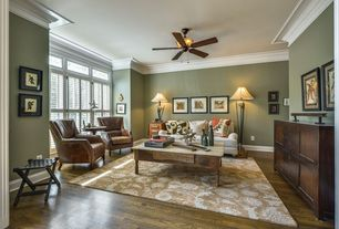 Traditional Living Room with Crown molding, Paint 1, Ceiling fan, Hardwood floors, Built-in bookshelf, Standard height