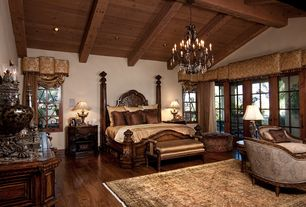 Mediterranean Master Bedroom with Exposed beam, Chandelier, French doors, Window cornice, Carved wood four poster bed, Paint