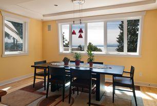 Modern Dining Room with Hardwood floors, Pendant light, Tilt Dining Chair, Emmerson reclaimed wood dining table