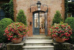 Traditional Front Door with Glass panel door, exterior stone floors