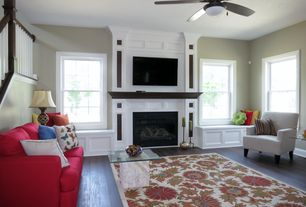 Traditional Living Room with Standard height, Cement fireplace, Window seat, Ceiling fan, Fireplace, Hardwood floors
