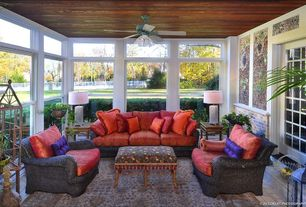 Eclectic Porch with Fence, Glass panel door, Screened porch, exterior tile floors