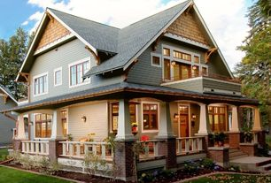 Craftsman Exterior of Home with Transom window, Cedar West Cedar Decorator Shingles, Raised beds, Glass panel door, Fence