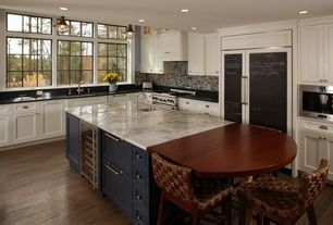 Traditional Kitchen with Glass panel, Breakfast bar, Flat panel cabinets, Undermount sink, Ceramic Tile, High ceiling