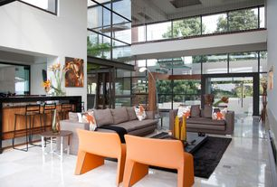 Contemporary Great Room with French doors, Columns, High ceiling, Concrete tile