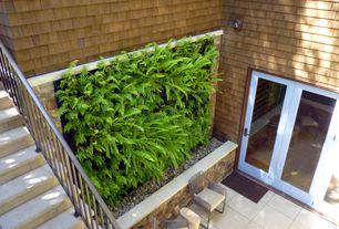 Cottage Landscape/Yard with Emser tile & natural stone ridge crest  quebec  engineered stone, Wood shingle siding