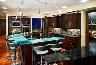 Modern Kitchen with Breakfast bar, Quartz counters, Undermount sink, Ceramic Tile, L-shaped, Pendant light, European Cabinets