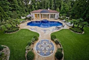 Mediterranean Swimming Pool with exterior stone floors, Pool with hot tub, Fence