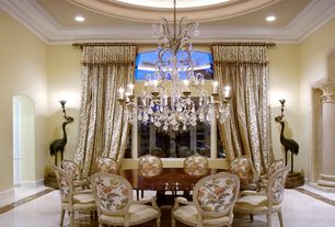 Traditional Dining Room with Paint, stone tile floors, specialty window, Crown molding, simple marble tile floors, can lights