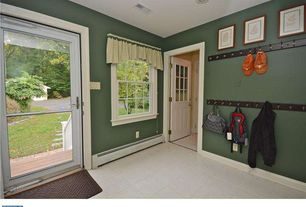 Traditional Entryway with limestone tile floors, French doors