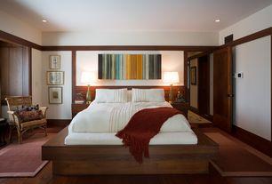 Contemporary Master Bedroom with Hardwood floors, Standard height, flat door, can lights