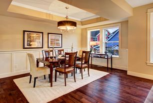 Traditional Dining Room with Crown molding, Macys metropolitan dining chair, splat back arm chair, Paint 1, Chandelier