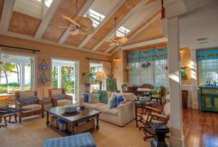 Tropical Great Room with Fanimation Islander 5 Palm Blade Ceiling Fan, French doors, Columns, Wall sconce, Ceiling fan