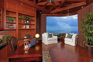 Traditional Home Office with Exposed beam, Built-in bookshelf, Ceiling fan, Hardwood floors, Crown molding