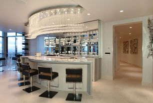 Art Deco Bar with sandstone floors, can lights, Chandelier, Standard height, Built-in bookshelf, interior wallpaper