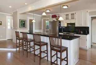 Traditional Kitchen with Pendant light, Kitchen island, Breakfast bar, Crown molding, Undermount sink, Glass panel door