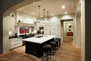 Traditional Kitchen with Hardwood floors, Subway Tile, Standard height, built-in microwave, Pendant light, full backsplash