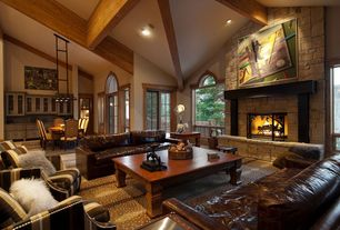 Craftsman Living Room with Cathedral ceiling, Carpet, Exposed beam, French doors, stone fireplace, Arched window