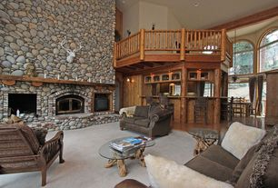 Rustic Living Room with other fireplace, Wall sconce, stone fireplace, Fireplace, insert fireplace, Arched window, Loft