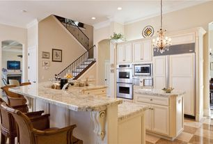Traditional Kitchen with Complex granite counters, One-wall, High ceiling, Flat panel cabinets, Crown molding, U-shaped