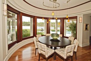 Modern Dining Room with Laminate floors, Pendant light