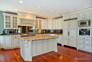 Traditional Kitchen with Built In Panel Ready Refrigerator, Laminate floors, Kitchen island, Custom hood, L-shaped, Casement