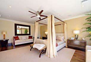 Modern Guest Bedroom with can lights, Hardwood floors, Crown molding, Standard height, flush light, Ceiling fan