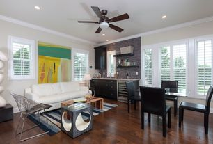 Eclectic Family Room with Hardwood floors, can lights, Standard height, flush light, Ceiling fan, Built-in bookshelf