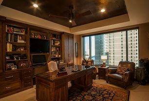 Traditional Home Office with can lights, Built-in bookshelf, High ceiling, Carpet, Ceiling fan, specialty window