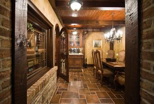 Craftsman Wine Cellar with Chandelier, Exposed beam, stone tile floors, interior brick, flush light, Columns, specialty door