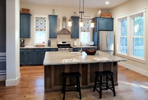 Contemporary Kitchen with Breakfast bar, Kitchen island, Complex granite counters, Flat panel cabinets, Farmhouse sink