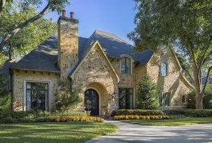 Traditional Exterior of Home with Tutor style home, Stone exterior