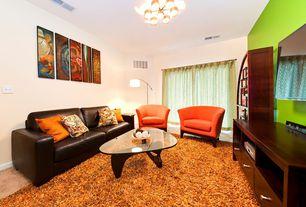 Modern Living Room with Hardwood floors, Built-in bookshelf, specialty window, Chandelier, Standard height
